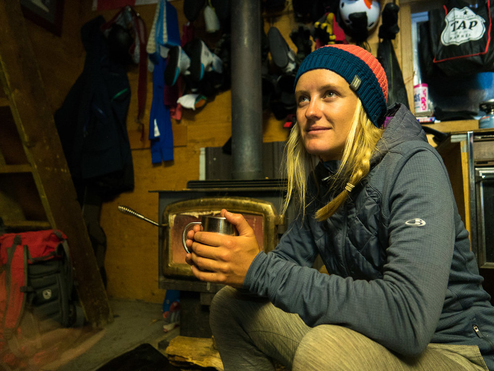 Soph enjoying the cosy hut by the fire. Photo: Pete Oswald