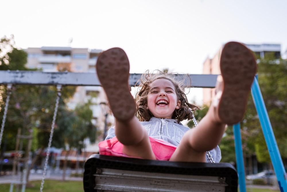 girl on the swing giggling.jpg