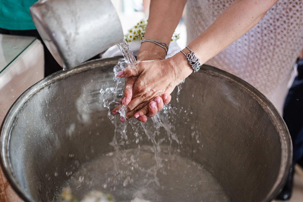 Christening cyprus βαπτιση  κυπρος water hands.jpg