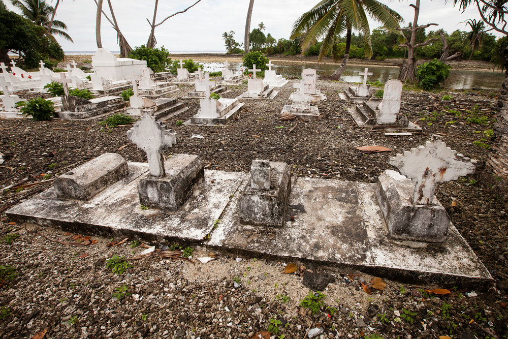 The graves of four babies who died as a result of complications due to radiation poisoning lie near the water's edge in Ejit. The Bikinians see the issue of climate change in a similar light to that of the nuclear testing conducted in the 1950s. They believe that the fault lies with the western world, yet they are the people who pay most dearly for it.
