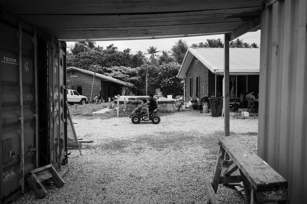 Young Nauruan children drive about on a four-wheel bike on Boxing Day, 2014. Nauru has a heavily materialistic culture, and despite many families not appearing to be greatly wealthy, are wont to buying flashy gifts.