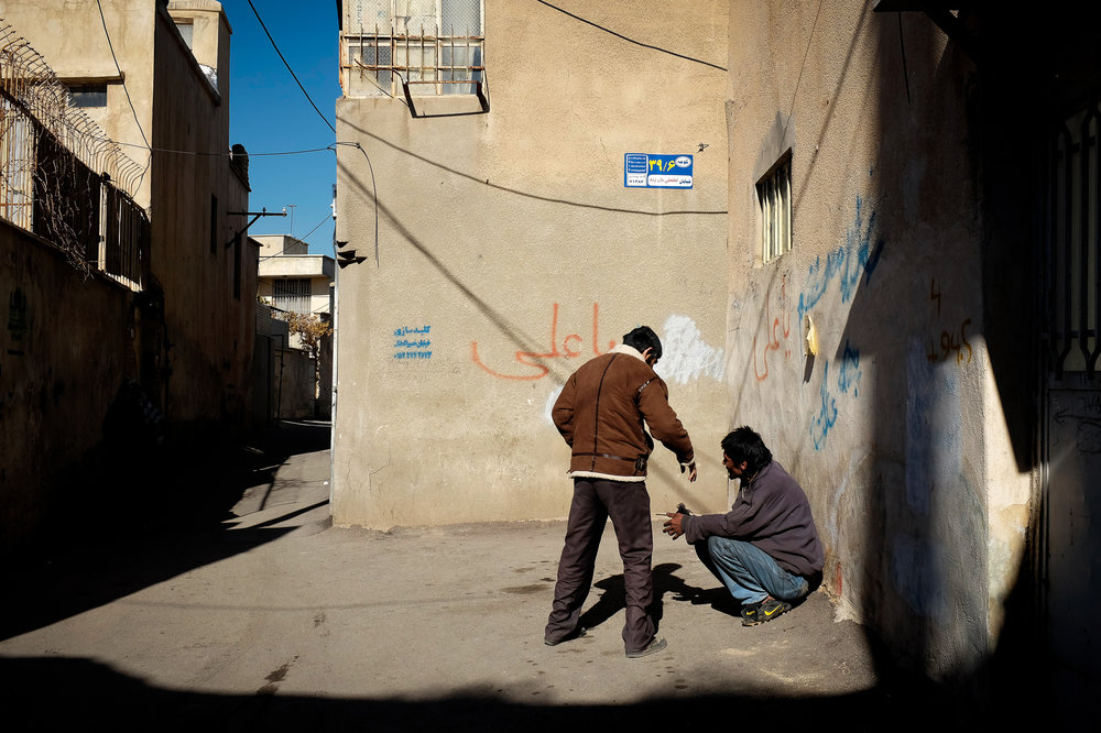 Two men buying and selling drugs in Shiraz. Despite drugs being outlawed in Iran, there is a growing population of drug addicts. Heroin is of particular concern in Iran, easily flowing in over the border with Afghanistan, but crystal meth is fast growing in use.