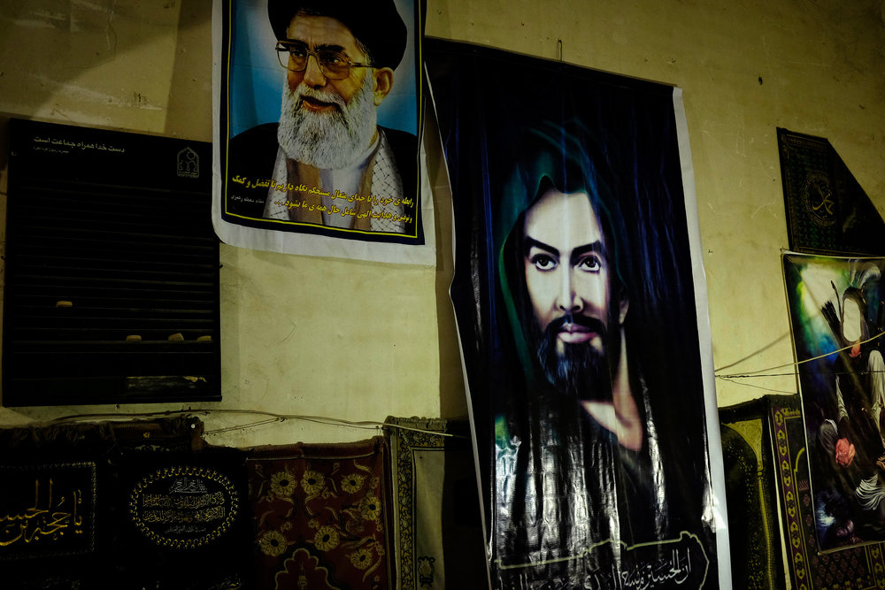 The Supreme Leader, Ayatollah Khamenei is depicted next to the Prophet Ali in a bazaar in Shiraz.