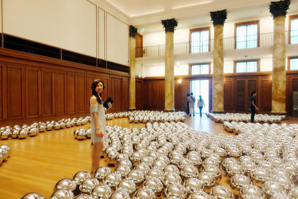 The Narcissus Garden, an installation of plastic silver globes to reflect and distort the images of the environment and the people around them.