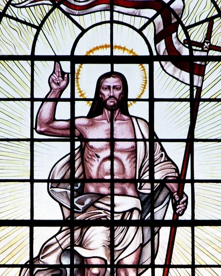 West Window - The stained glass representation of the Risen Lord was a gift of Lady Hogan in 1991 in memory of her late husband, Sir Michael Hogan.