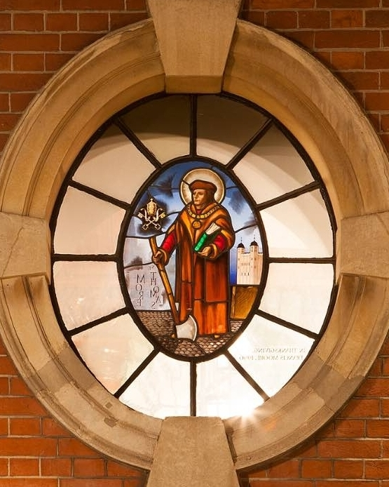 Roundel Windows - These two stained glass windows were executed at the same time as the West Window.  The one north of the door is of St. Thomas More and was a gift of the Moore family; the one south of the door is of St. Francis of Assisi, a gift of the then parish priest, Father Patrick Nolan.