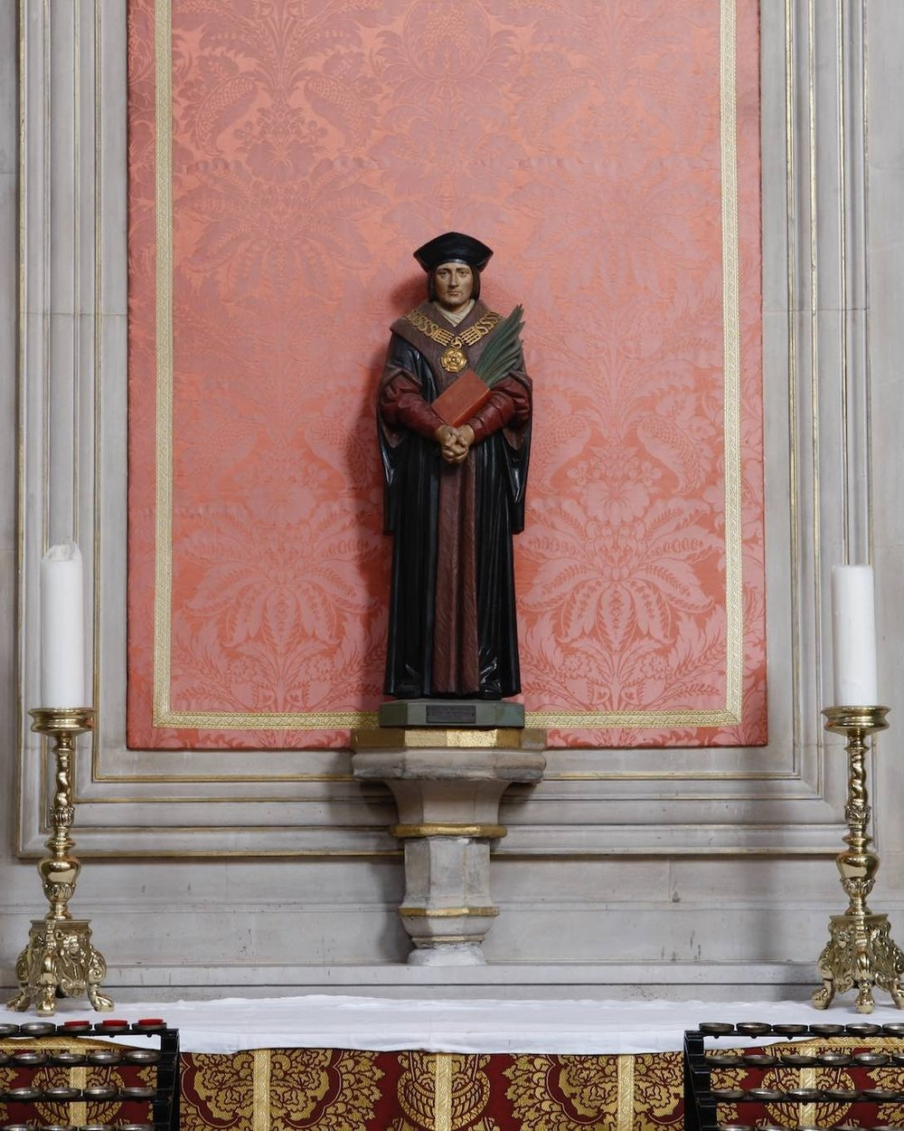 St. Thomas More altar - This altar was commissioned by the then parish priest, Father Philip Valentin, to commemorate St. Thomas More's canonisation, with St. John Fisher, by Pope Pius XI in 1935, 400 years after their martyrdom.  A reliquary containing a first class relic of St. Thomas, acquired from the Belgian convent entered by More's step-daughter, Alice Alington, used to stand on this altar, but it was stolen in the 1960s.  The feast day of St. John Fisher and St. Thomas More is June 22nd.  Pope John Paul II declared St. Thomas More the patron saint of statesmen and politicians on October 31st, 2000.