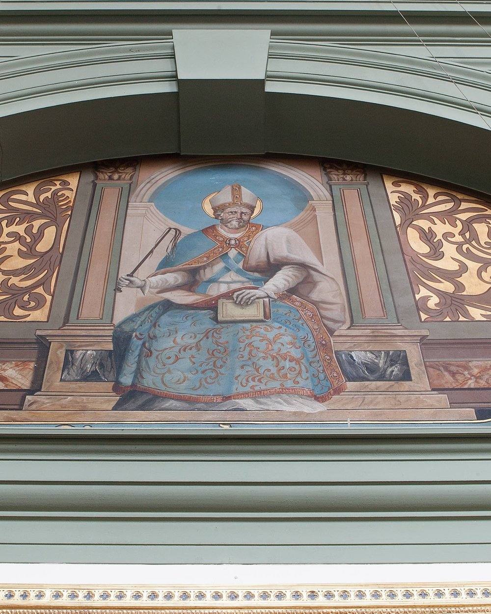 St. Ambrose - Born in 339 or 340, the son of the Roman prefect of Gaul, Ambrose initially pursued a career in law.  Appointed by the emperor to conduct the election of the Bishop of Milan, he was instead persuaded by popular acclaim to accept the appointment himself.  Because he was only a catechumen at that time, he received baptism and ordination to the diaconate, presbyterate and episcopate all within the space of a week in 374. He baptised Augustine on Holy Saturday, 387, and died on Holy Saturday, 4th April 397.  His feast day is December 7th, the anniversary of his ordination as a bishop.