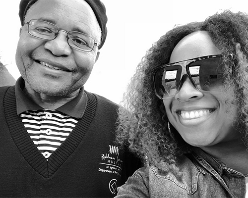 Kierra Sheard poses with Robben Island tour guide Ntando Mbatha who was imprisoned with Mandela for 7 years (Photo Credit: Instagram)