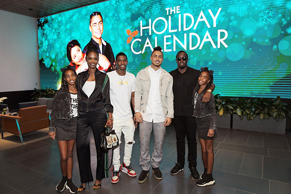 """(L-R) Kim Porter, Christian Casey Combs, Quincy Brown, Sean """"Diddy"""" Combs,.D'Lila Star Combs and Jessie James Combs attend """"The Holiday Calendar"""" Special Screening Los Angeles at NETFLIX Icon Building on October 30, 2018 in Los Angeles, California. (Credit: Getty)"""