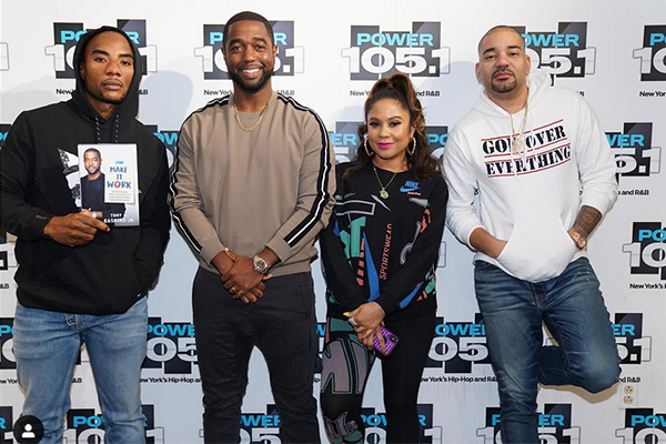 """Tony Gaskins poses for a picture with the crew from The Breakfast Club (Left to Right: Charlamagne tha God, Tony Gaskins, Angela Yee, DJ Envy"""")"""