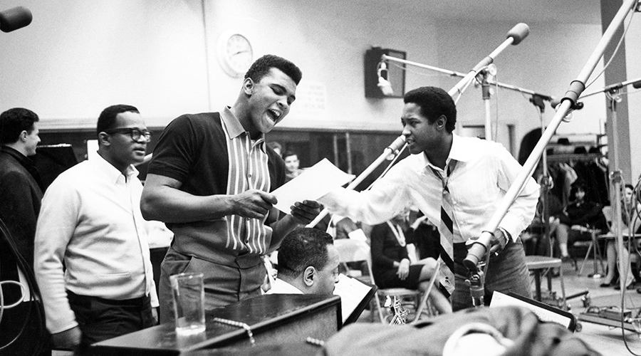 Sam Cooke (right), who was very active in the civil rights movement before his death, is pictured here with Muhammad Ali (center) [Credit: Getty]