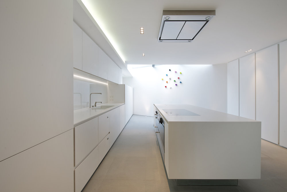 The full renovation of a Georgian townhouse in the heart of Kensington - The entire interior of the house was removed apart from the floor joists.   Thompson + baroni designed an entirely new staircase with Tin Tab using Corian treads, laser- cut steel stringers and American oak boards.   The kitchen was also entirely made of Corian including the cupboard doors and work surfaces. The ground floor and all of the bathroom walls and floors were finished in Pietra Serena which is an Italian sandstone used widely in Florence.