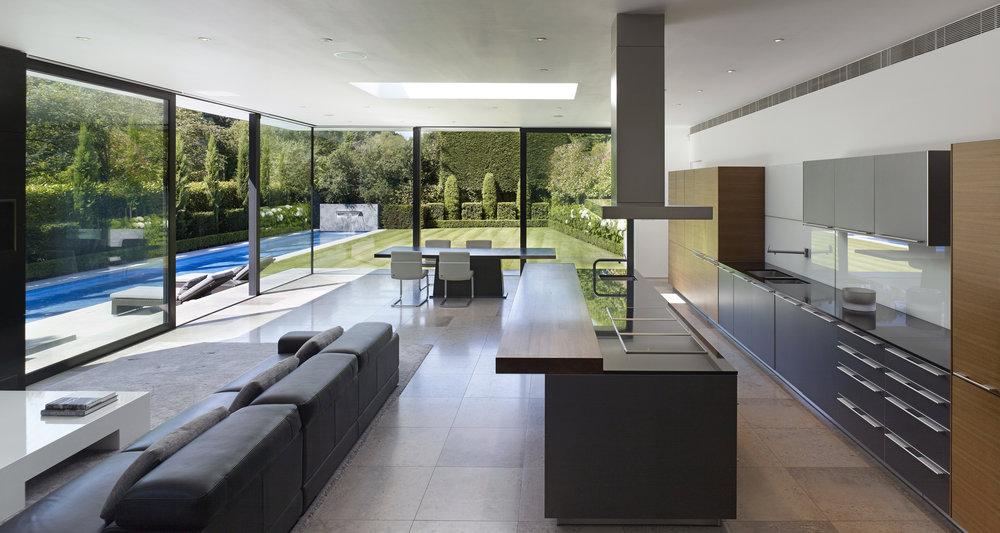 Award WinningLuxury House Renovation London, including swimming pool jacuzzi car lift and gym, by minimalist London architect practice Thompson + Baroni