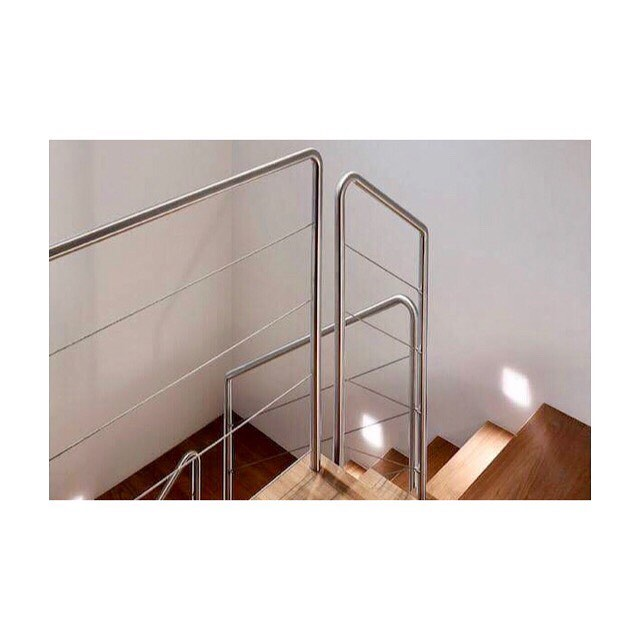 American walnut clad stairs with a lightweight stainless steel balustrade #stairs #america #walnut #staircase