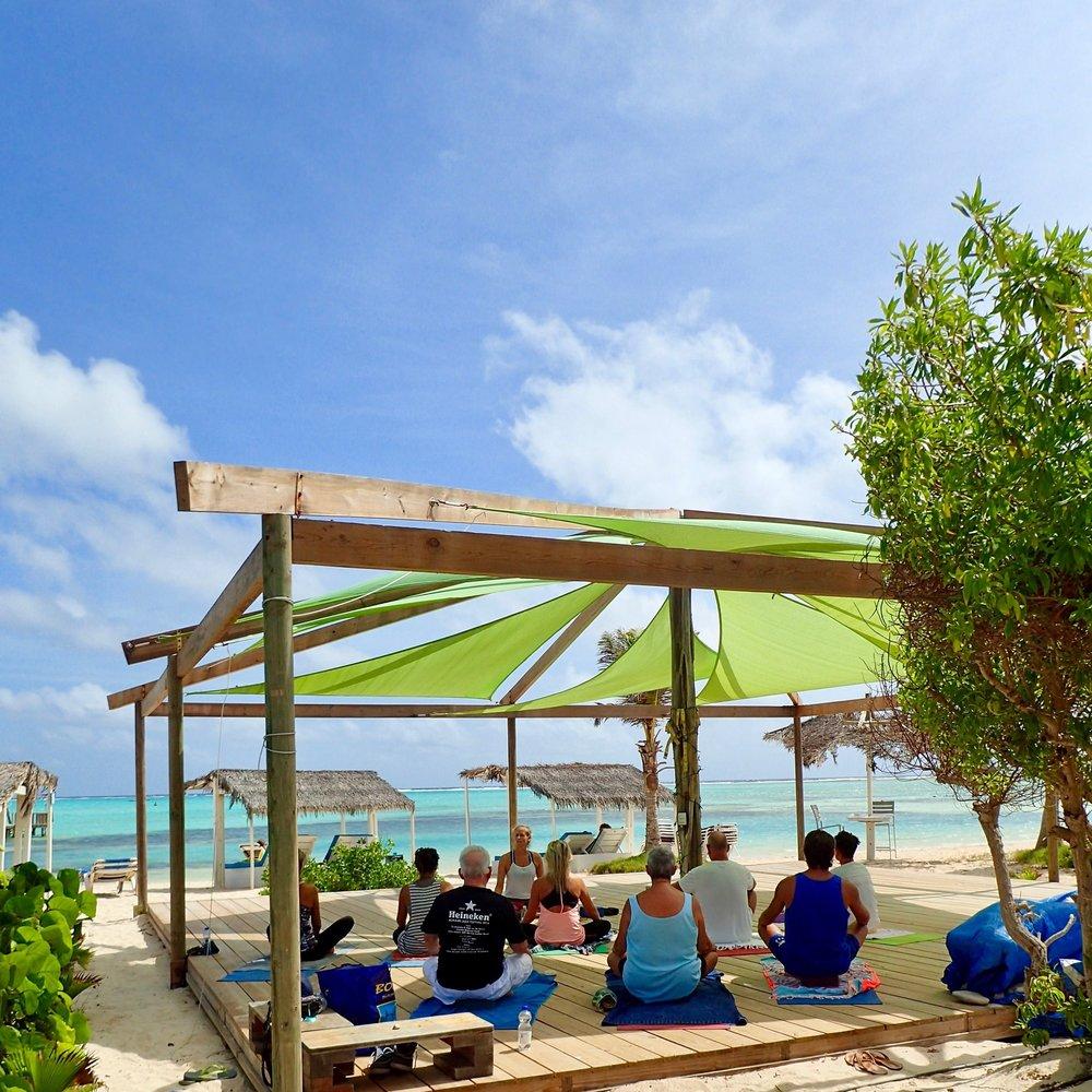 Yoga session on the beautiful yoga deck at Sorobon, Bonaire