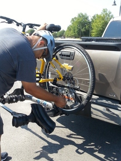 Tonnya Kohn's husband loading her bike after they rode at Ft. Jackson.