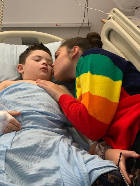 Isabella in hospital with Lucus when he was in recovery after having his gallbladder removed recently; she adores him