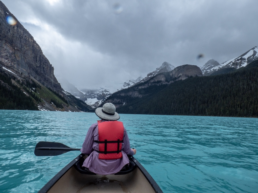 Got caught in a rain storm while canoeing Lake Louise.