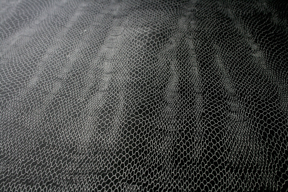 Descent explores a transformative process of drawing, exploring the medium as a way of understanding and investigating patterns in nature and consciousness representing a train of thought, the meditative drawing of undulating line aims to represent the abstract process of thinking. The continuous pattern manifests from regular sequence to unstable waves relating to the potential of metamorphosis within human rumination. As the flow of line begins to expand and contract, areas simultaneously open up and close together, creating a veil-like form rippling across the plate. The veil's dual capacity to simultaneously expose and conceal is expressed in the physical effect of its presence on copper, the plate acting as a mirror of it's contemplative viewer whilst encompassing their form within the wavering pattern before them.  The etching series, 'Descent' was produced for the exhibition The Yellow Wallpaper at COB Gallery, addressing the gradual decline of the protagonist in Charlotte Perkins Gilman's polemic feminist work of the same name, after becoming absorbed into the patterns she saw within her wallpaper.   The Yellow Wallpaper  was on show from 22nd June - 21st July 2012 at Cob Gallery London.