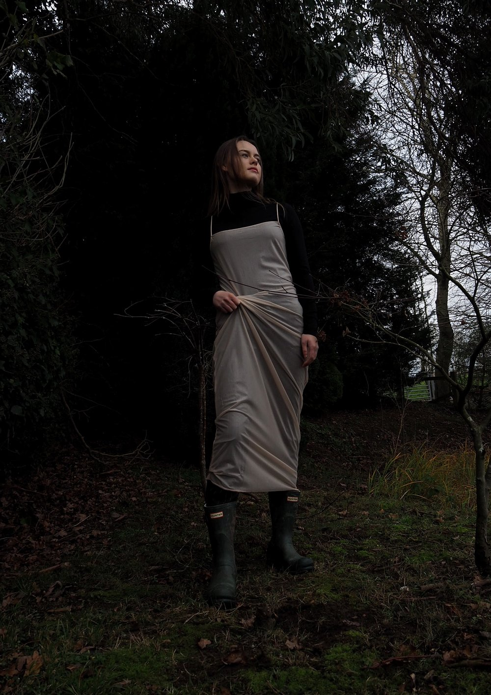 Emily wears vintage sheer dress, vintage trousers, jumper by ASOS, boots by Hunter