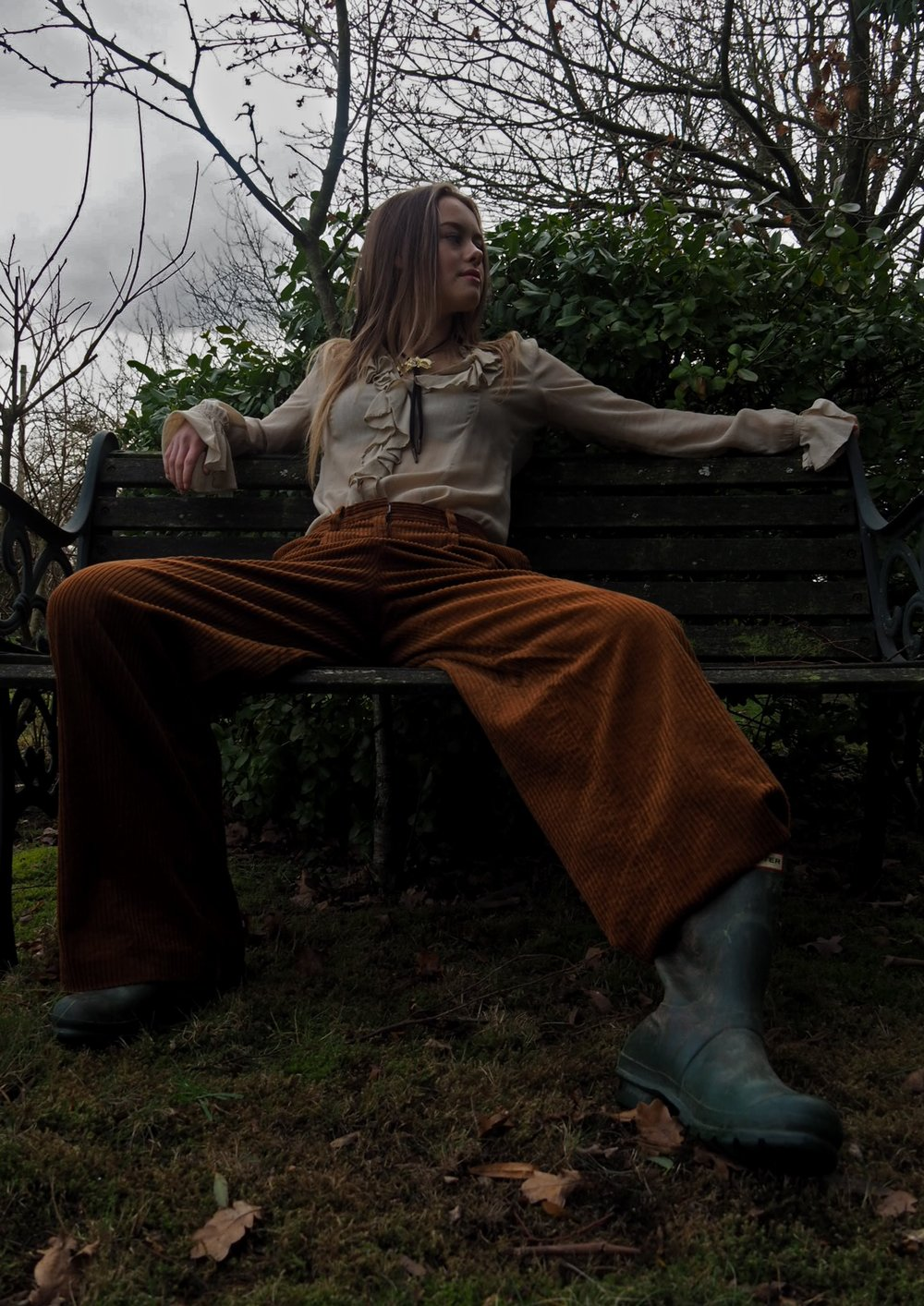 Emily wears vintage blouse, vintage necklace, trousers by H&M, boots by Hunter