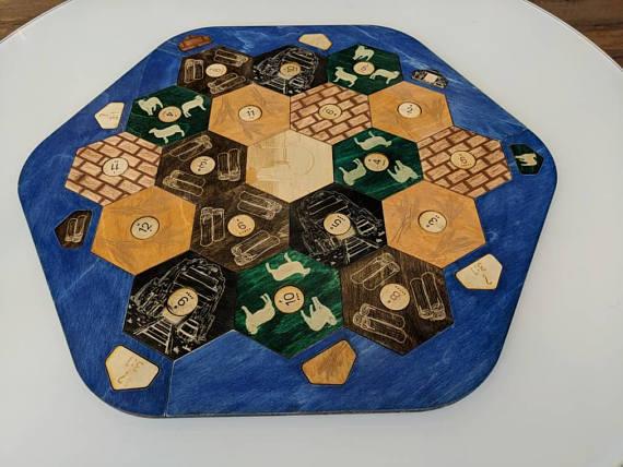 Check out Josh's custom catan board -