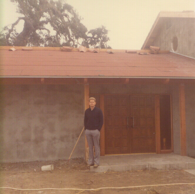 doug_standing_first_building.jpg