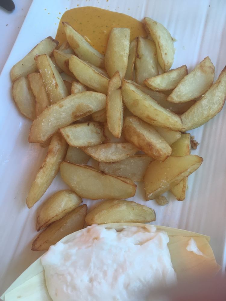 French fries and  alioli ― garlicy mayonaise.