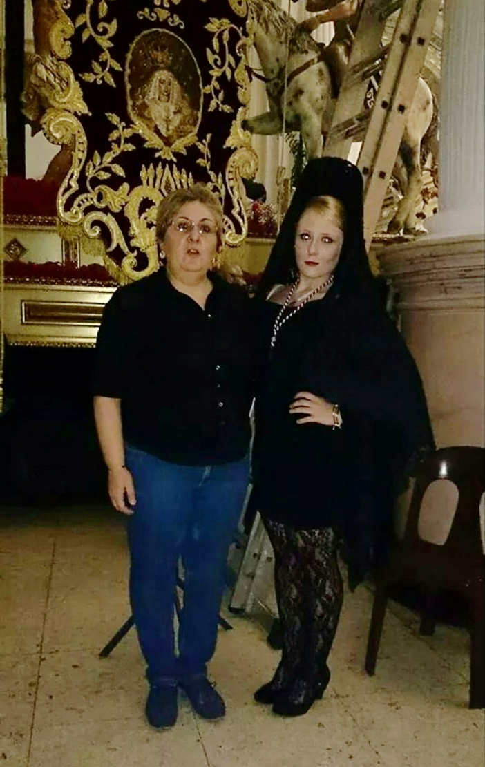 One of my Spanish friends proudly participates in the processions as a  mantilla .