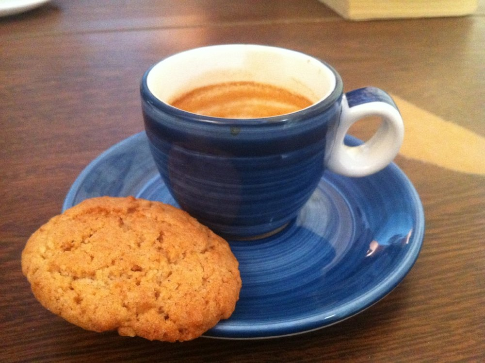 A  café cortado  and homemade cookie at my favorite coffee shop in Granada.