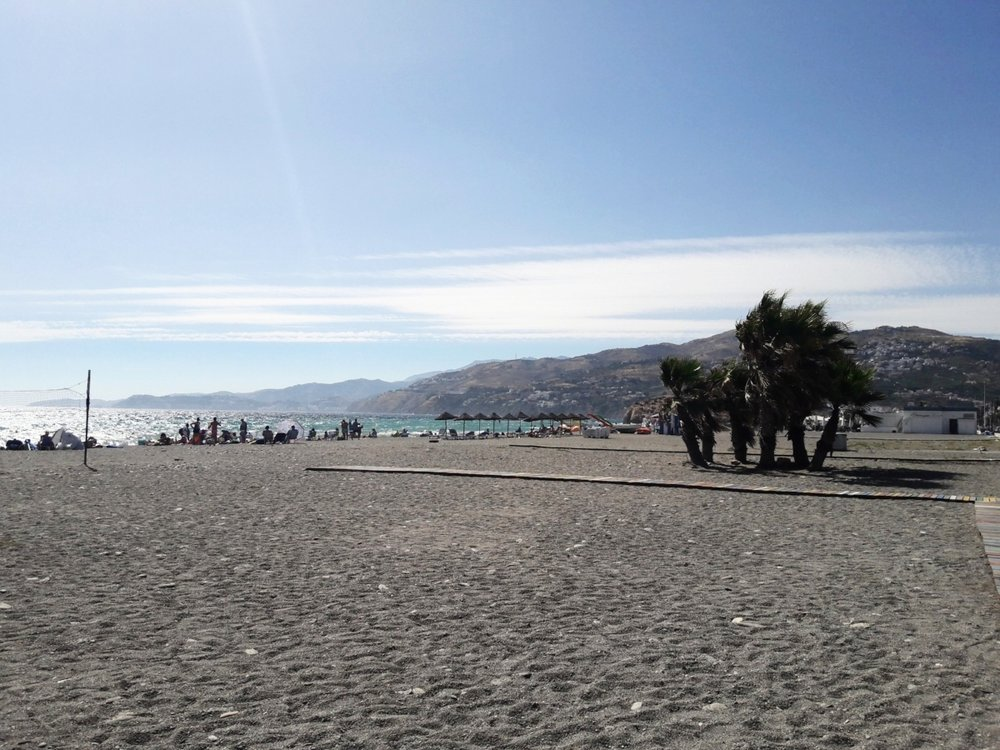 Although the sand is rockier, the views are still lovely along the Granada coast. (Pictured: Salobreña)