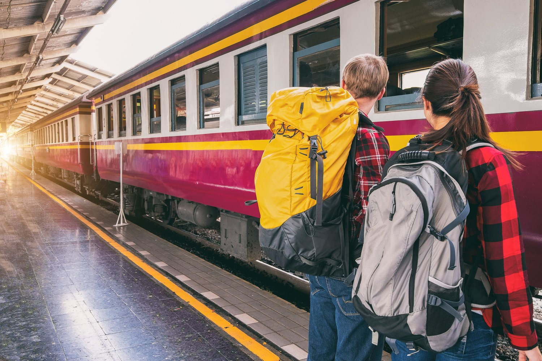 fa389779eff0 People using backpacks while boarding a train. Photo source veerasak  Piyawatanakul on Pexels.