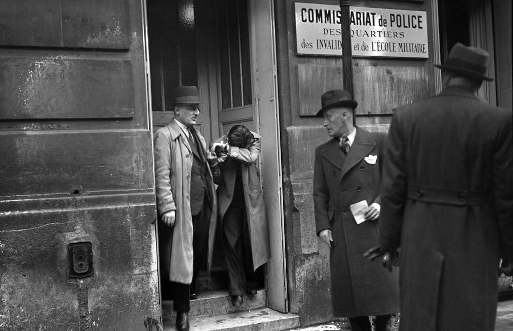 Images of Herschel Gryszpan being taken into police custody after shooting Ernst vom Rath