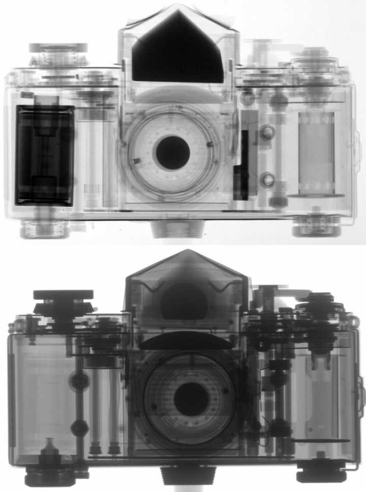 An N-ray image (top) and X-ray image (bottom) of a camera. Note how both imaging techniques show off different layers of the object