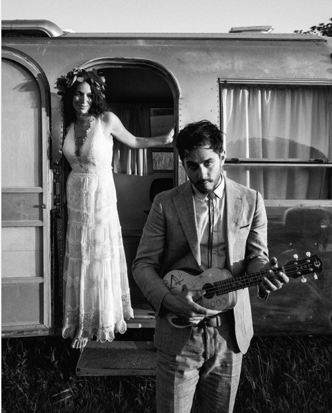 hudson-valley-farm-weddings-pioneer-farm-weddings-warwick-ny-bride-and-groom-outside-of-airstream.png