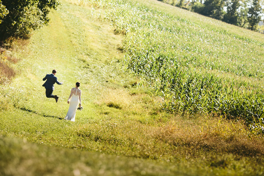 hudson-valley-farm-weddings-pioneer-farm-weddings-warwick-ny-just-married-couple-in-farmland.jpg