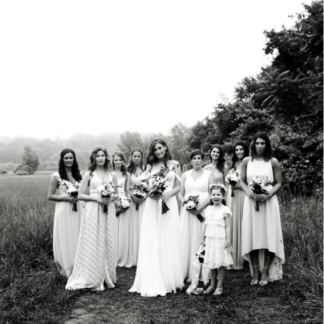 hudson-valley-farm-weddings-pioneer-farm-weddings-warwick-ny-bride-standing-with-bridal-party-black-and-white.png