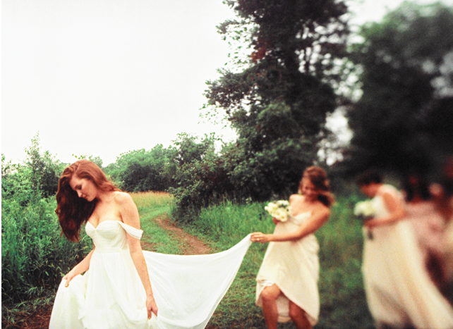 hudson-valley-farm-weddings-pioneer-farm-weddings-warwick-ny-bridesmaid-holding-brides-wedding-dress.png