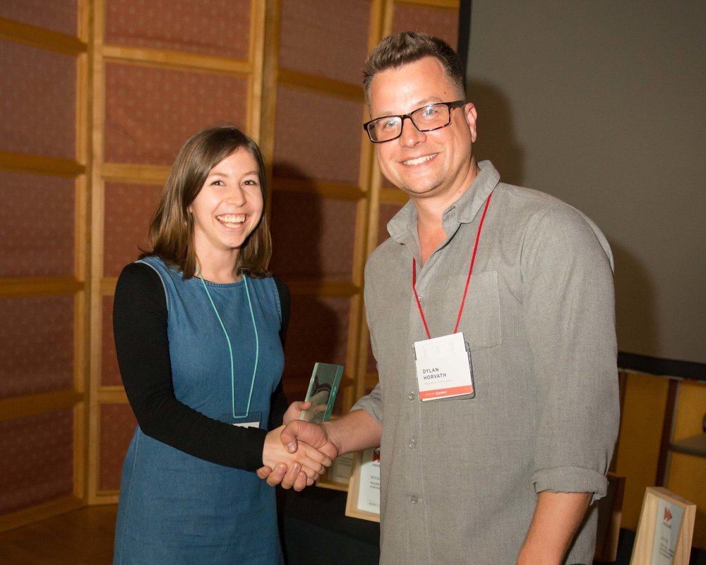 Caroline Smeek accepting the Cortex Design User Experience Award from Dylan Horvath.