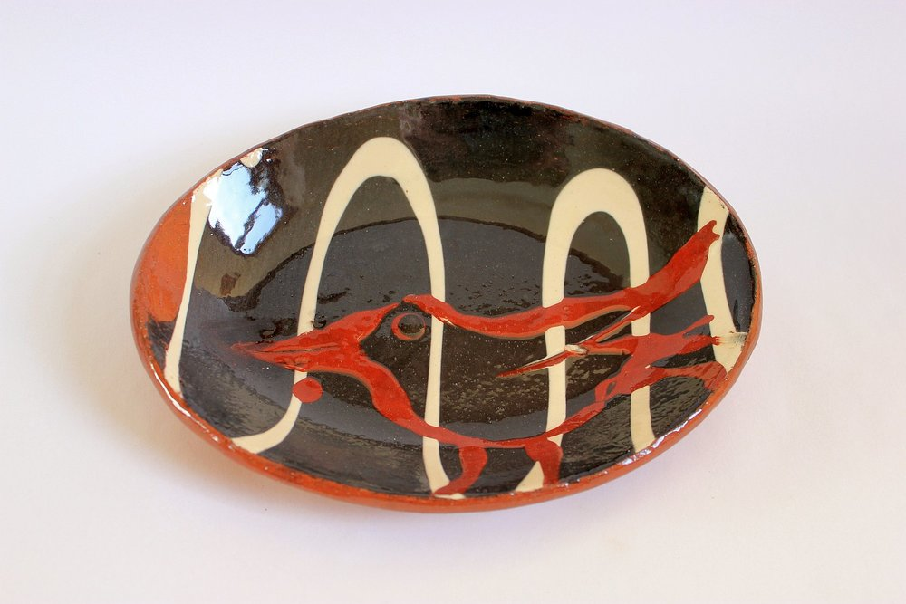 Oval earthenware slipped dish with bird