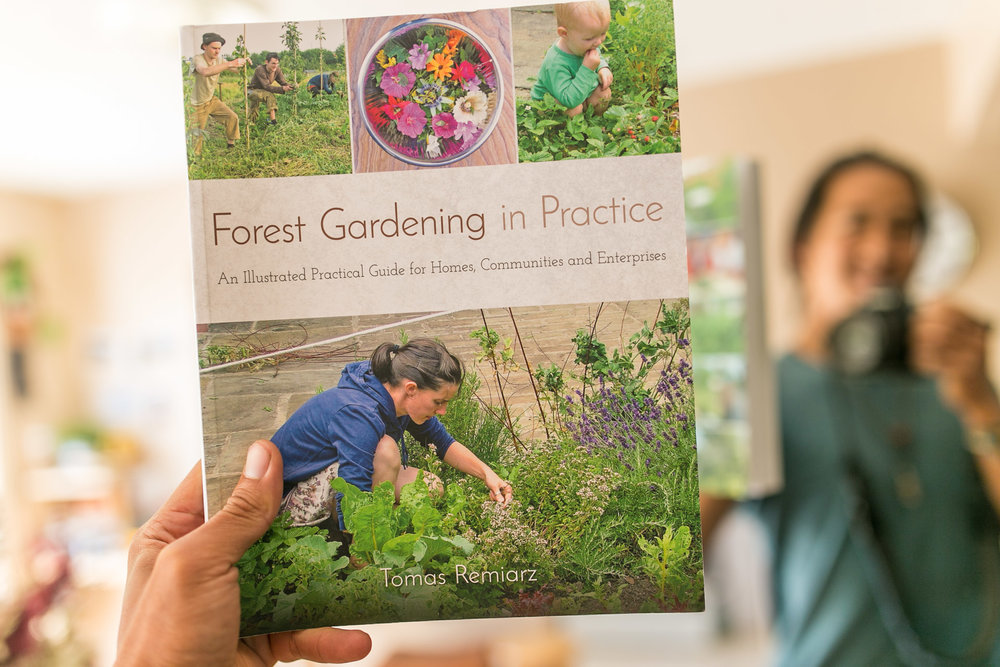 Forest Gardening in Practice  , a book by Tomas Remiarz featuring food forests and permaculture-inspired gardens worldwide.