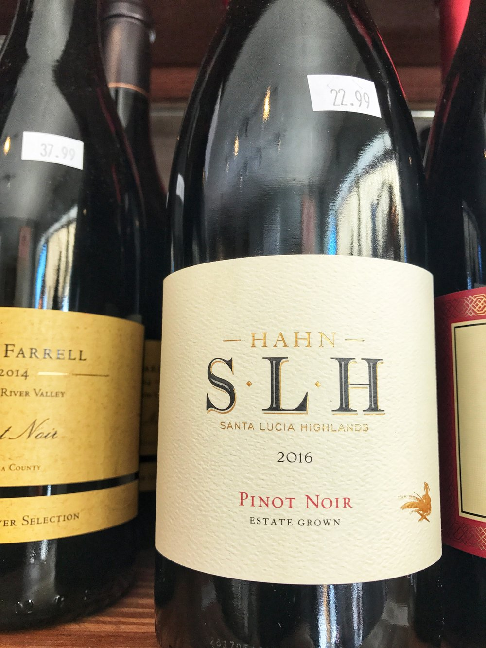 2016 Hahn SLH Pinot Noir, Santa Lucia Highlands $22.99 - A perennial favorite and always a stellar value.    Tasting NotesAromas of bright red cherry, strawberry with hints of earth, spices, and toasty oak. An explosion of red fruit including strawberry, cherry and raspberry welcome the palate finish with refined tannins and a soft mouthfeel.  Vineyard Notes55% Smith Vineyard, 30% Doctors Vineyard, 10% Hook Vineyard, 5% Lone Oak Vineyard  Winemaker NotesAfter the fruit has been carefully picked and sorted, it is fermented in open-top stainless steel tanks. We then age this Pinot Noir for up to 11 months in a selection of small, 60-gallon French oak barrels. When the wine is ready to be blended, our winemaker selects only those barrels that exemplify the aromas and flavors of the Santa Lucia Highlands.