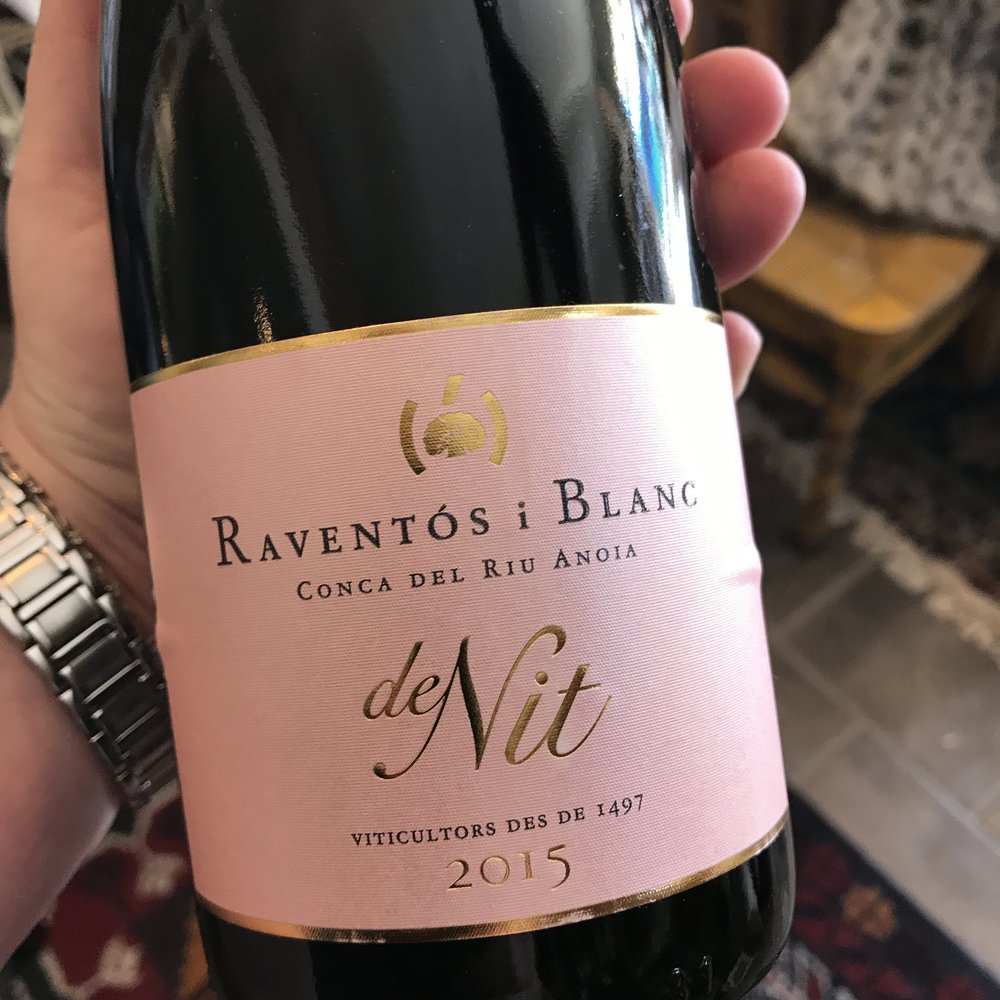 Raventos i Blanc's 2015 'De Nit' is a blend of 42% Macabeo, 37% Xarel.lo and 14% Parrellada with the addition of 7% Monastrell for complexity and its pale pink color. A pale, subdued and elegant pink color with clean, pure and almost crystalline aromas of light citrus, red flowers, white fruit, and a touch of cassis. The clean nose evolves with a smooth, voluminous and fruity texture, pleasant freshness and fine bubbles. Driven by a very good balance, with low dosage (Extra Brut). $21.99 All grapes come from estate-owned, biodynamically-farmed vineyards in the Anoia River valley. The primary fermentation is in stainless steel with the secondary fermentation in bottle. It is aged for at least 18 months on the lees before release. 'De Nit' means 'Of the Night' in Catalan.