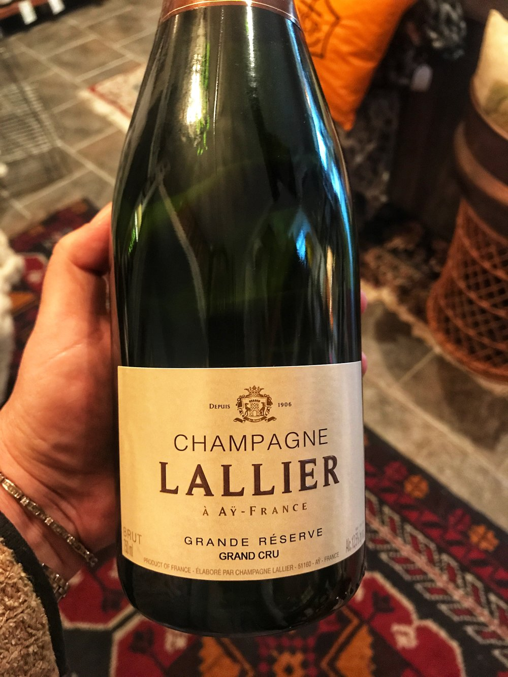 "NV Champagne Lallier ""Grande Réserve"" Grand Cru: (Reg. 57.99/Sale 48.99) Made from 100% Grand Cru grapes, of which 65% Pinot Noir from Aÿ and Verzenay and 35% Chardonnay from Avize and Cramant, the Brut is an intoxicating blend of 70% of the most recent vintage with 30% reserve wine, matured 24 to 36 months in our cellars. With 9 g/L dosage and 3 to 5 months rest between disgorgement and shipping, the Lallier Brut features a fine golden-yellow color and delicate buttery brioche aromas with hints of apricot and crusty bread. With its creamy mouthfeel, incredible balance, and remarkable minerality, this Brut represents a truly remarkable value."
