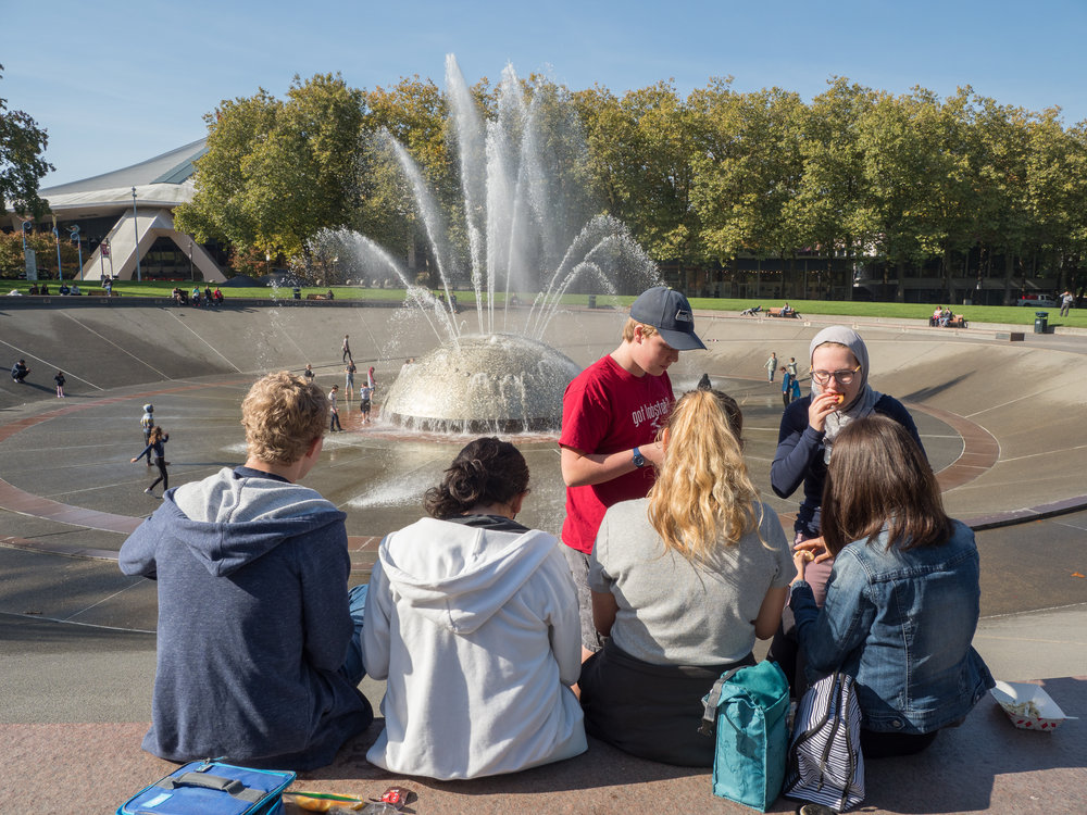students enjoying lunch at the seattle center international fountain