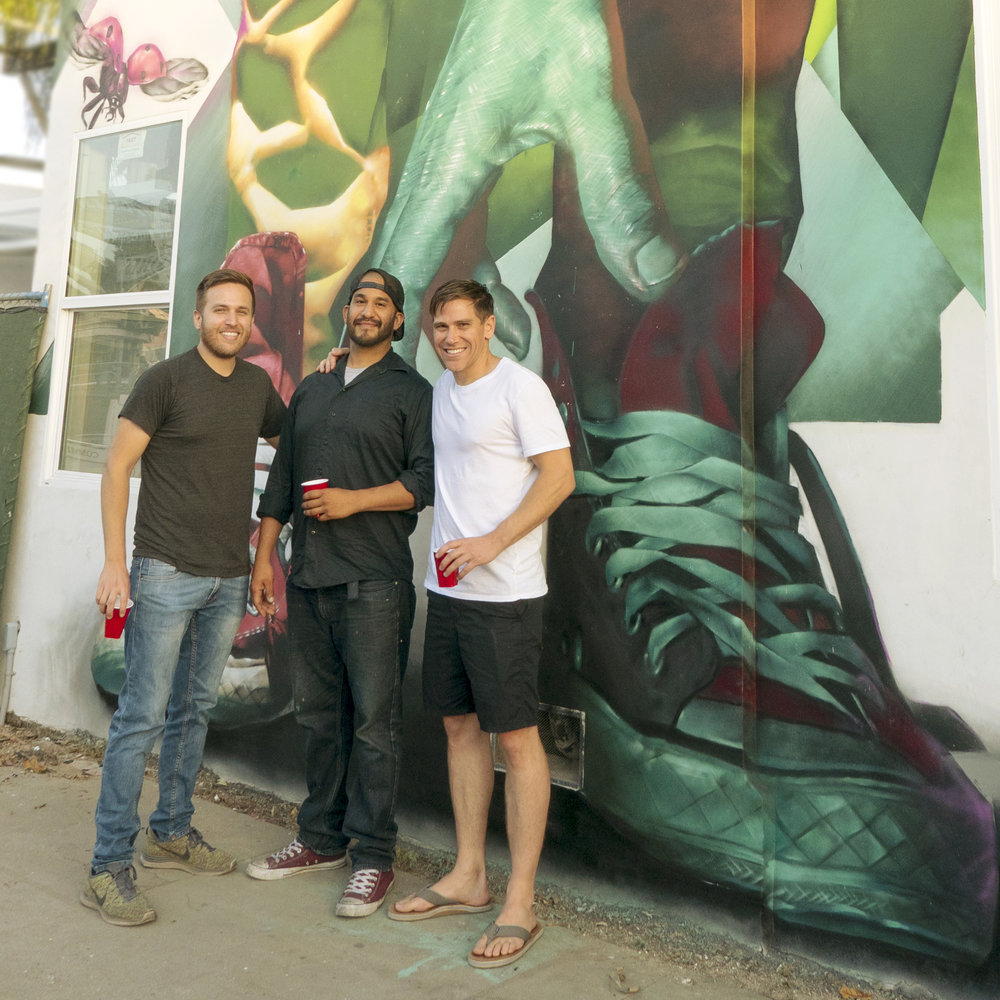 Nick Fenmore, artist Robert Enoe and Nick Halaris in front of a ColorLA mural