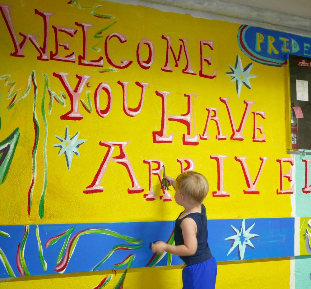 Ben introduces his dinosaur to the mural.