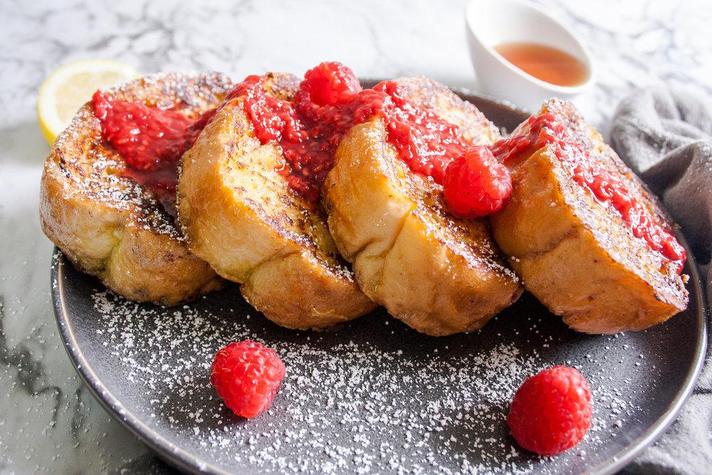 Eggnog French Toast with Bourbon Raspberry Sauce