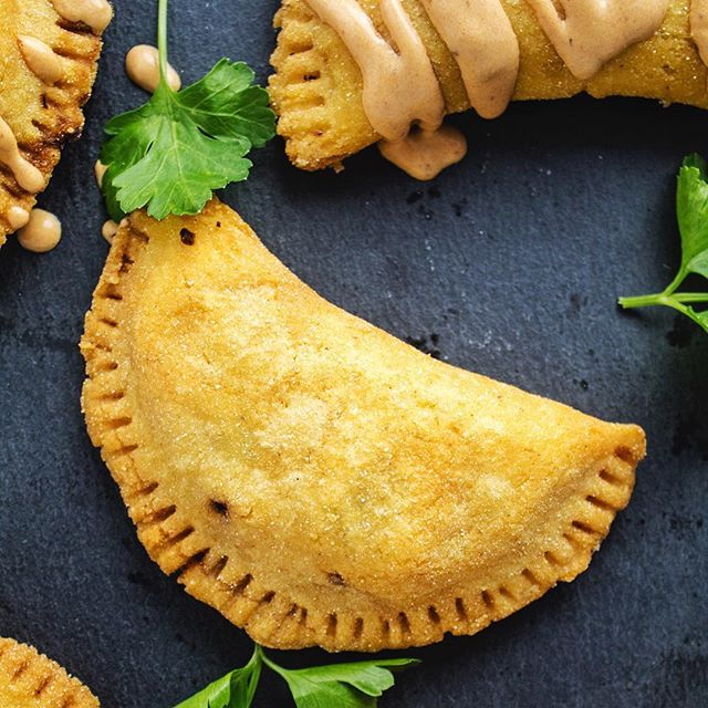 "Are you tired of these ""Arempanadas"" yet? If you are that's too bad because today is #NationalEmpanadaDay! ~~~~~~~~~~~~~~~~~~~~~~~~~~~~~~~~~~~~ Empanadas are so versatile, from the dough it's made from to the fillings to the sauces on the side! Around the world it has many names but I think we can all agree that they're just wonderful little hot pockets of deliciousness! Go check out my version linked in my bio! ✌🏽"